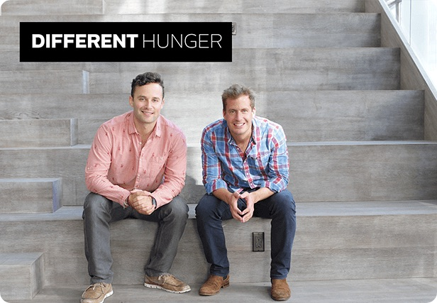 Different Hunger founders sitting on steps