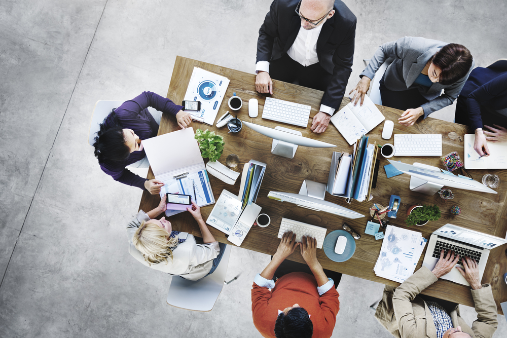 Overhead view of team working at a table